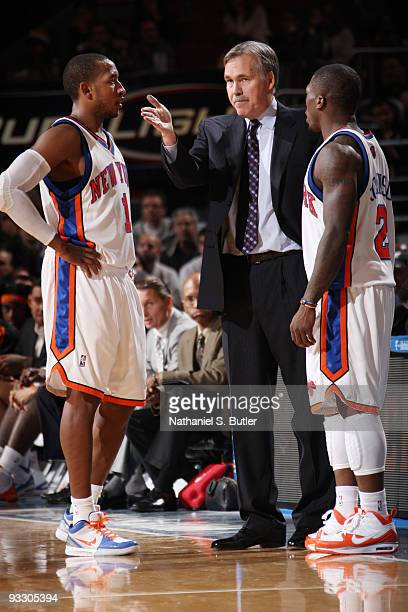 Head Coach Mike D'Antoni speaks to Chris Duhon and Nate Robinson of the New York Knicks during game against the Boston Celtics on November 22 2009 at...