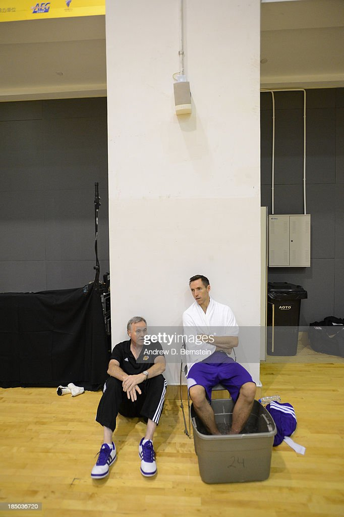 Head Coach Mike D'Antoni speaks to Steve Nash of the Los Angeles Lakers during practice as part of the 2013 Global Games on October 17, 2013 at the Oriental Sports Center Shanghai, China.