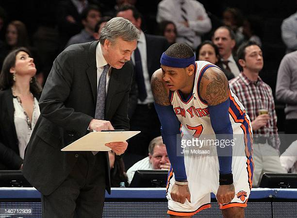 Head coach Mike D'Antoni talks with Carmelo Anthony of the New York Knicks during a timeout against the Phoenix Suns on January 18 2012 at Madison...