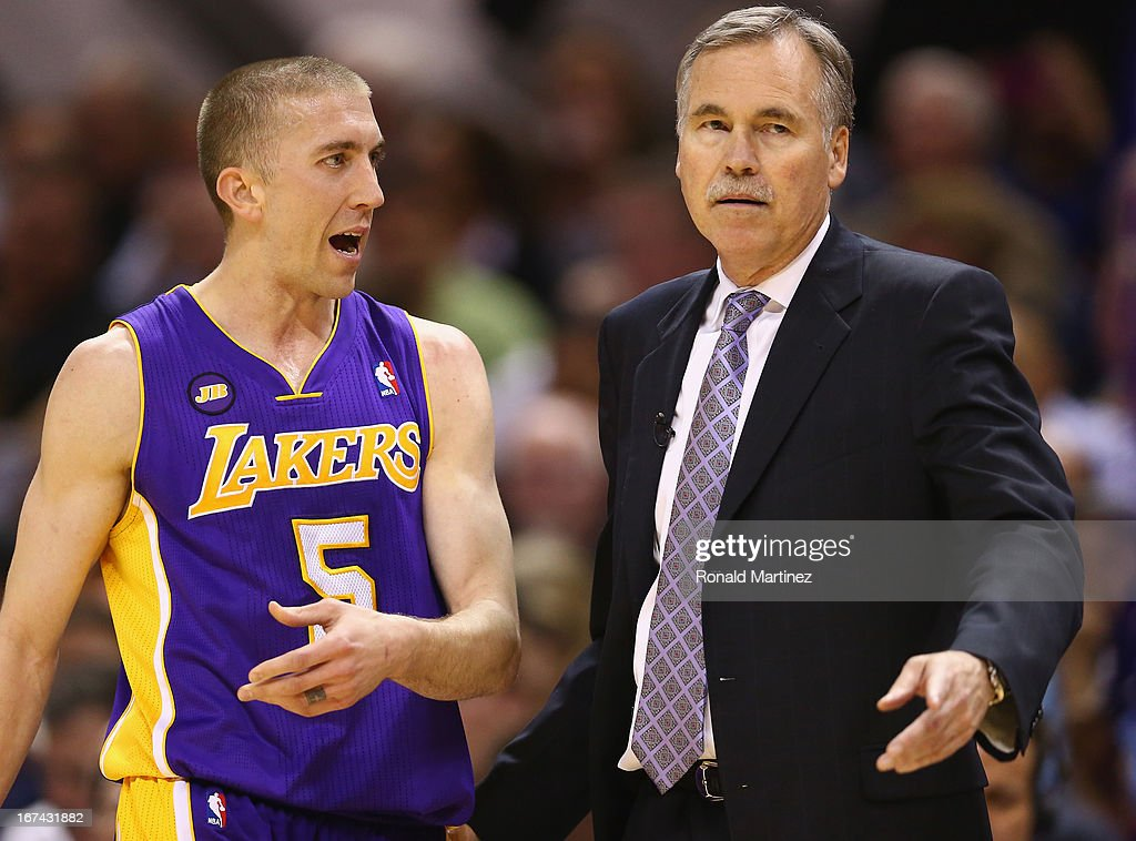 Head coach Mike D'Antoni talks with Steve Blake #5 of the Los Angeles Lakers during Game Two of the Western Conference Quarterfinals of the 2013 NBA Playoffs at AT&T Center on April 24, 2013 in San Antonio, Texas.