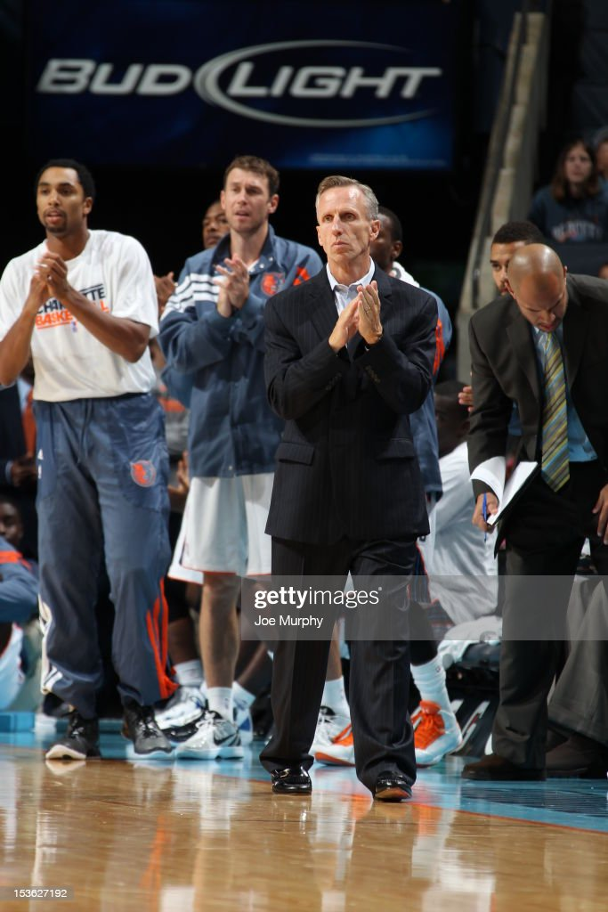 Head Coach <a gi-track='captionPersonalityLinkClicked' href=/galleries/search?phrase=Mike+Dunlap&family=editorial&specificpeople=3957174 ng-click='$event.stopPropagation()'>Mike Dunlap</a> of the Charlotte Bobcats applauds during the game between the Charlotte Bobcats and the Washington Wizards at the Time Warner Cable Arena on October 7, 2012 in Charlotte, North Carolina.