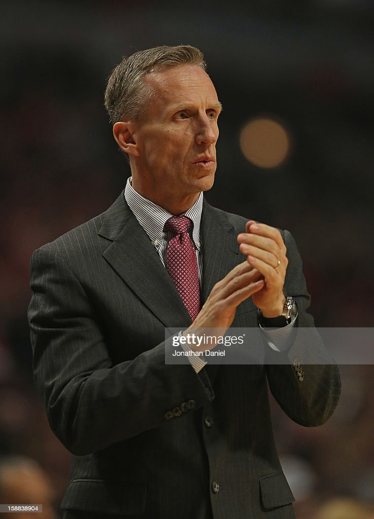 Head coach Mike Dunlap of the Charlotte Bobcats encourages his team during a game against the Chicago Bulls at the United Center on December 31, 2012 in Chicago, Illinois. The Bobcats defeated the Bulls 91-81.