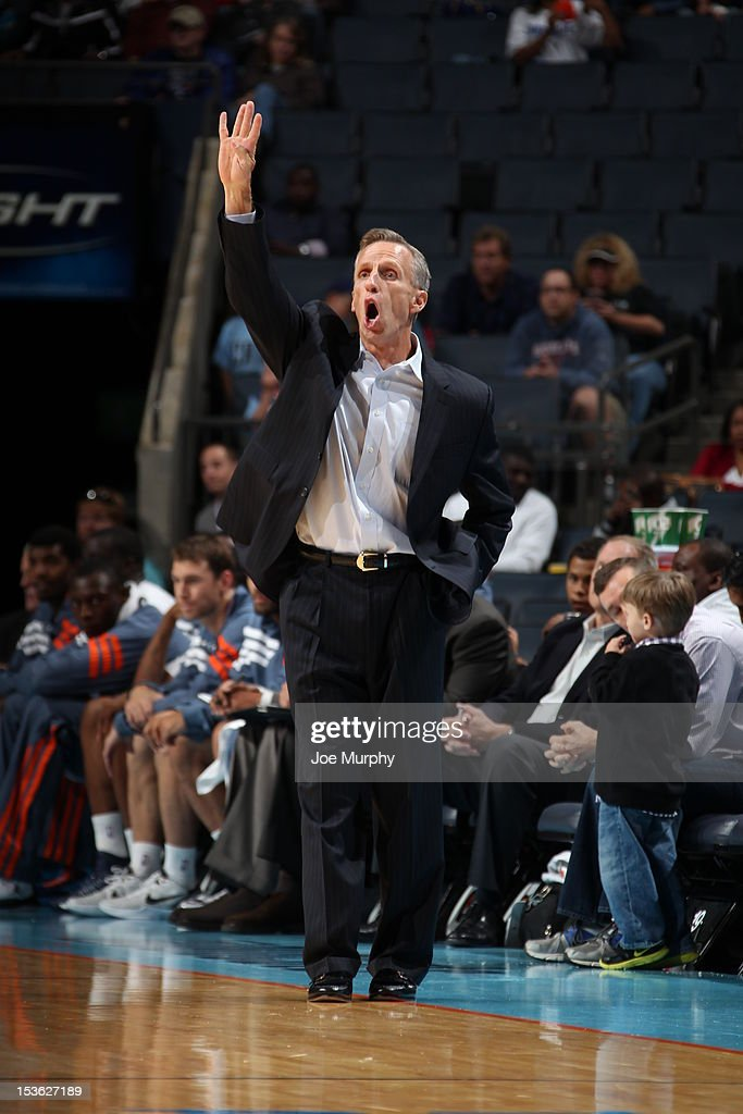 Head Coach <a gi-track='captionPersonalityLinkClicked' href=/galleries/search?phrase=Mike+Dunlap&family=editorial&specificpeople=3957174 ng-click='$event.stopPropagation()'>Mike Dunlap</a> of the Charlotte Bobcats gestures during the game between the Charlotte Bobcats and the Washington Wizards at the Time Warner Cable Arena on October 7, 2012 in Charlotte, North Carolina.