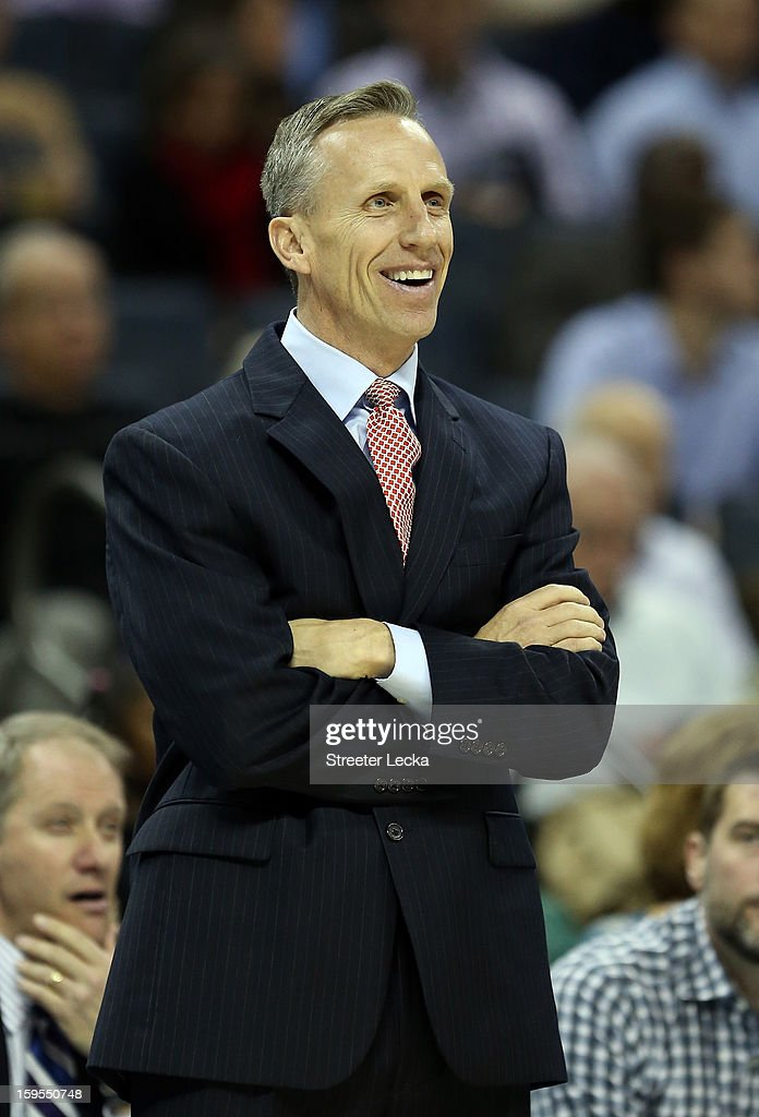 Head coach <a gi-track='captionPersonalityLinkClicked' href=/galleries/search?phrase=Mike+Dunlap&family=editorial&specificpeople=3957174 ng-click='$event.stopPropagation()'>Mike Dunlap</a> of the Charlotte Bobcats reacts as he watches on against the Indiana Pacers during their game at Time Warner Cable Arena on January 15, 2013 in Charlotte, North Carolina.