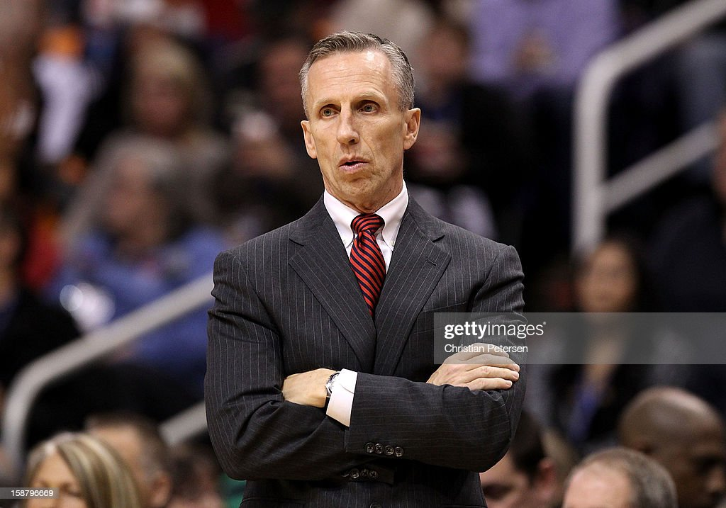 Head coach <a gi-track='captionPersonalityLinkClicked' href=/galleries/search?phrase=Mike+Dunlap&family=editorial&specificpeople=3957174 ng-click='$event.stopPropagation()'>Mike Dunlap</a> of the Charlotte Bobcats reacts during the NBA game against the Phoenix Suns at US Airways Center on December 19, 2012 in Phoenix, Arizona. The Suns defeated the Bobcats 121-104.
