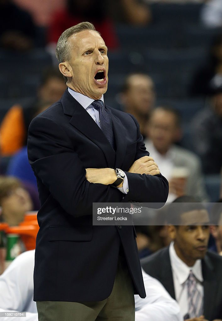 Head coach Mike Dunlap of the Charlotte Bobcats yells to his team during their game against the Utah Jazz at Time Warner Cable Arena on January 9, 2013 in Charlotte, North Carolina.