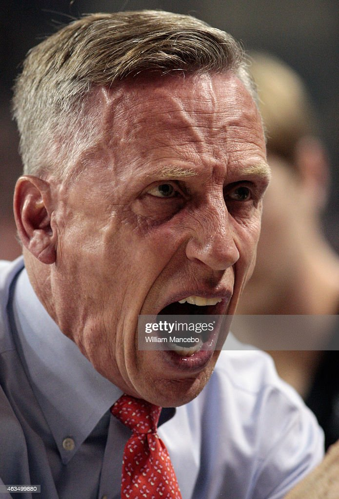 Head coach <a gi-track='captionPersonalityLinkClicked' href=/galleries/search?phrase=Mike+Dunlap&family=editorial&specificpeople=3957174 ng-click='$event.stopPropagation()'>Mike Dunlap</a> of the Loyola Marymount Lions huddles with his players during a timeout in the first half against the Gonzaga Bulldogs at McCarthey Athletic Center on February 12, 2015 in Spokane, Washington. Gonzaga defeated Loyola Marymount 80-51.