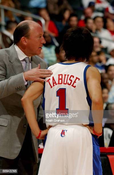 Head coach Mike Dunleavy Sr of the Los Angeles Clippers speaks to Clipper Yuta Tabuse during the game against the Dallas Mavericks on October 12 2005...