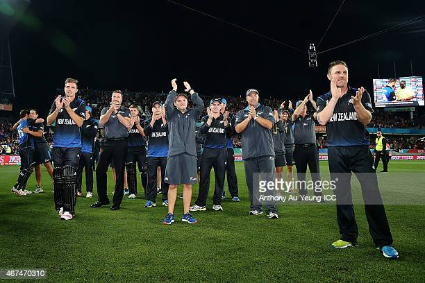 Head Coach Mike Hesson of New Zealand and the rest of team congratulate as Grant Elliott is being named Player of the Match after the 2015 Cricket...
