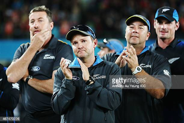 Head Coach Mike Hesson of New Zealand congratulates as Grant Elliott is being named Player of the Match after the 2015 Cricket World Cup Semi Final...