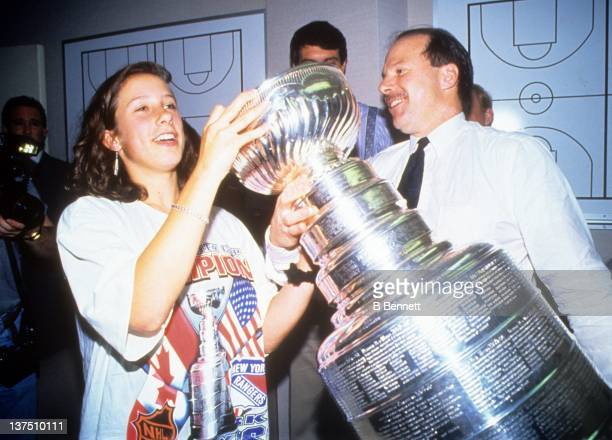 Head coach Mike Keenan of the New York Rangers celebrates in the locker room with the Stanley Cup after the Rangers defeated the Vancouver Canucks in...