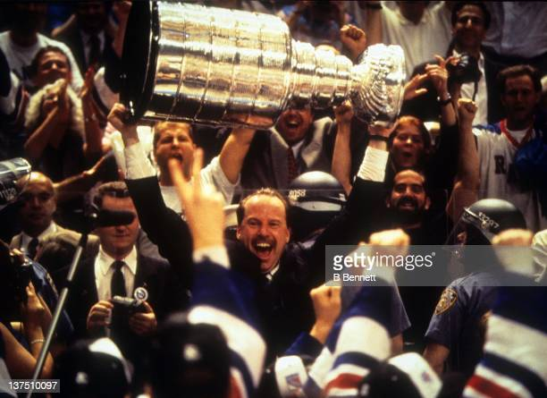 Head coach Mike Keenan of the New York Rangers celebrates with the Stanley Cup after the Rangers defeated the Vancouver Canucks in Game 7 of the 1994...