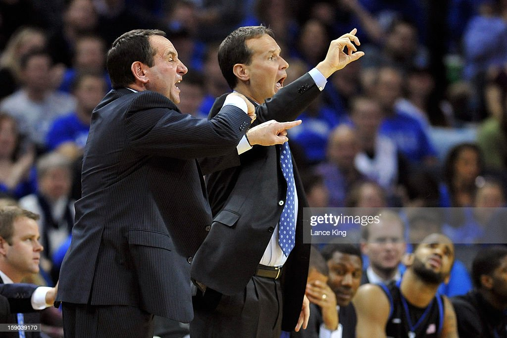 Head Coach Mike Krzyzewski (L) and Associate Head Coach Chris Collins of the Duke Blue Devils signal instructions to their team against the Davidson Wildcats at Time Warner Cable Arena on January 2, 2013 in Charlotte, North Carolina. Duke defeated Davidson 67-50.