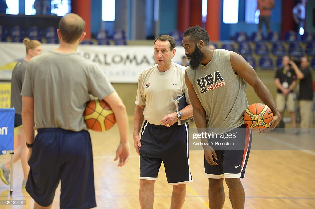 Head coach Mike Krzyzewski and James Harden #13 of the USA Basketball Men's National Team chat during practice on August 24, 2014 at Pabellon de El Tablero Practice Facility in El Tablero, Gran Canaria, Spain.