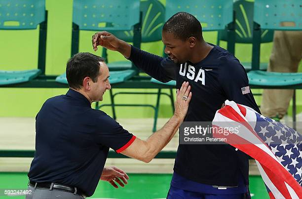 Head coach Mike Krzyzewski and Kevin Durant of United States celebrate after defeating Serbia during the Men's Gold medal game on Day 16 of the Rio...
