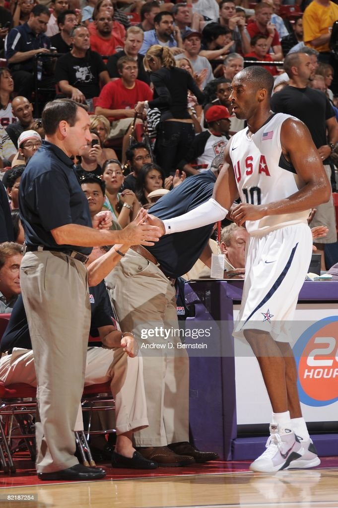 Head coach Mike Krzyzewski and <a gi-track='captionPersonalityLinkClicked' href=/galleries/search?phrase=Kobe+Bryant&family=editorial&specificpeople=201466 ng-click='$event.stopPropagation()'>Kobe Bryant</a> #10 of the USA Basketball Men's Senior National Team high five during the State Farm USA Basketball Challenge against the Canadian National Team on July 25, 2008 at the Thomas and Mack Center in Las Vegas, Nevada. The USA won 120-65.