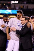 Head coach Mike Krzyzewski and Lance Thomas of the Duke Blue Devils celebrate after they won 6159 against the Butler Bulldogs during the 2010 NCAA...