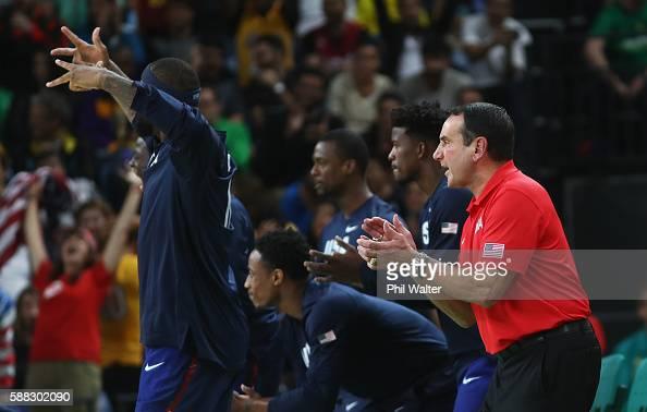 Head coach Mike Krzyzewski Demarcus Cousins Demar DeRozan Jimmy Butler and Harrison Barnes of United States celebrate during the Men's Preliminary...