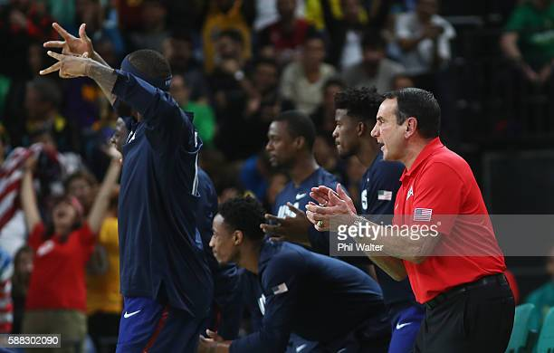 Head coach Mike Krzyzewski Demarcus Cousins Demar DeRozan Jimmy Butler and Harrison Barnes of United States celebrate during the Men's Preliminary...