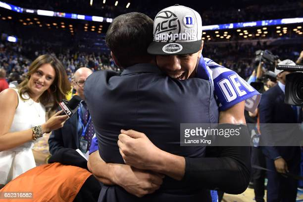 Head coach Mike Krzyzewski hugs Jayson Tatum of the Duke Blue Devils following their 7569 victory against the Notre Dame Fighting Irish during the...