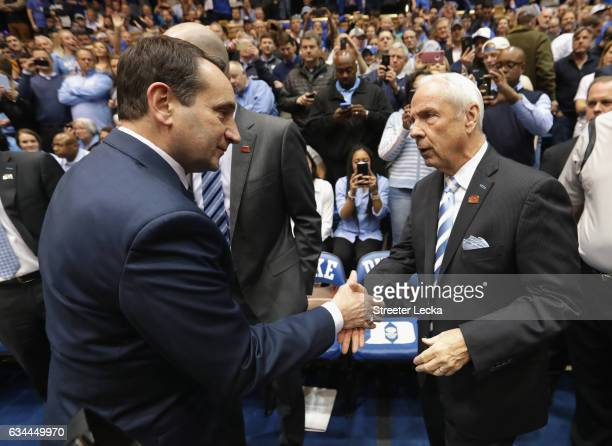 Head coach Mike Krzyzewski of the Duke Blue Devils and head coach Roy Williams of the North Carolina Tar Heels shake hands prior to their gaem at...