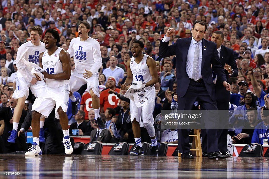 Head coach <a gi-track='captionPersonalityLinkClicked' href=/galleries/search?phrase=Mike+Krzyzewski&family=editorial&specificpeople=213322 ng-click='$event.stopPropagation()'>Mike Krzyzewski</a> of the Duke Blue Devils and his bench react after a play in the second half during the NCAA Men's Final Four National Championship at Lucas Oil Stadium on April 6, 2015 in Indianapolis, Indiana.