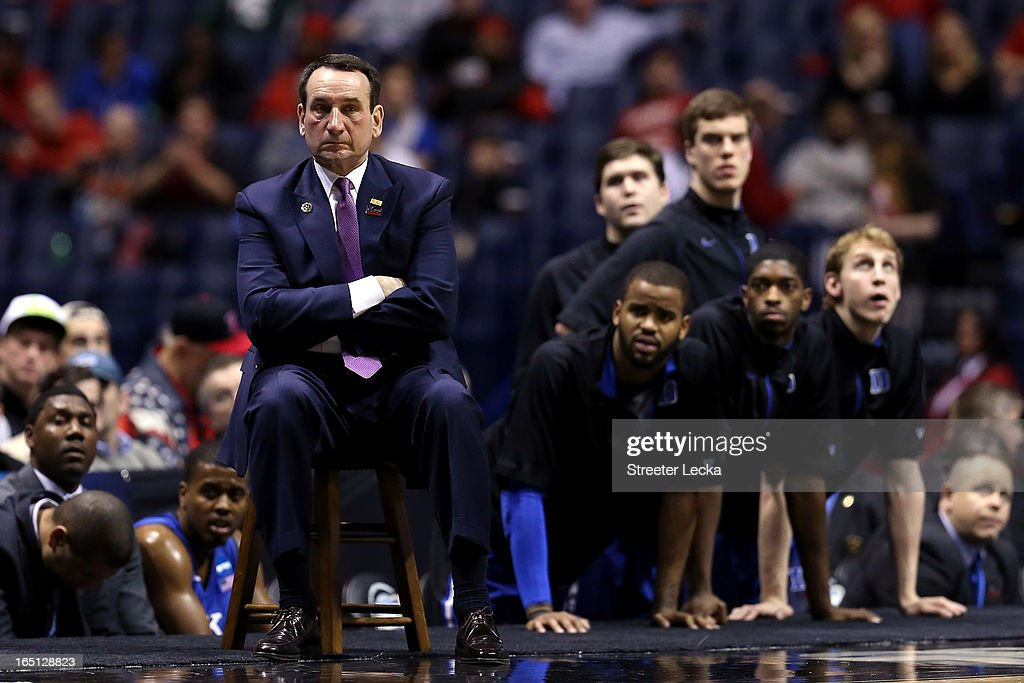 Head coach Mike Krzyzewski of the Duke Blue Devils and his players look on dejected against the Louisville Cardinals during the Midwest Regional Final round of the 2013 NCAA Men's Basketball Tournament at Lucas Oil Stadium on March 31, 2013 in Indianapolis, Indiana.