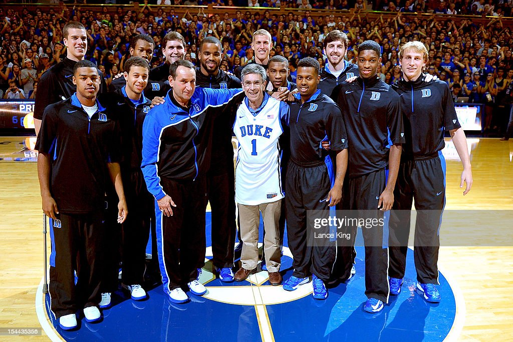 Head Coach <a gi-track='captionPersonalityLinkClicked' href=/galleries/search?phrase=Mike+Krzyzewski&family=editorial&specificpeople=213322 ng-click='$event.stopPropagation()'>Mike Krzyzewski</a> (front, left) of the Duke Blue Devils and his team honor Dr. <a gi-track='captionPersonalityLinkClicked' href=/galleries/search?phrase=Robert+Lefkowitz&family=editorial&specificpeople=5544453 ng-click='$event.stopPropagation()'>Robert Lefkowitz</a> (center) during Countdown to Craziness at Cameron Indoor Stadium on October 19, 2012 in Durham, North Carolina. Dr. Lefkowitz was a recent winner of the Nobel Prize in Chemistry.
