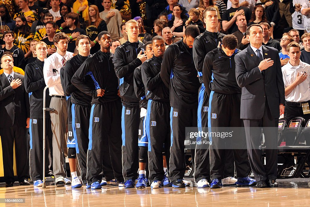 Head Coach Mike Krzyzewski of the Duke Blue Devils (right, front) and players of his team stand at attention during the National Anthem prior to a game against the Wake Forest Demon Deacons at Lawrence Joel Coliseum on January 30, 2013 in Winston-Salem, North Carolina. Duke defeated Wake Forest 75-70.