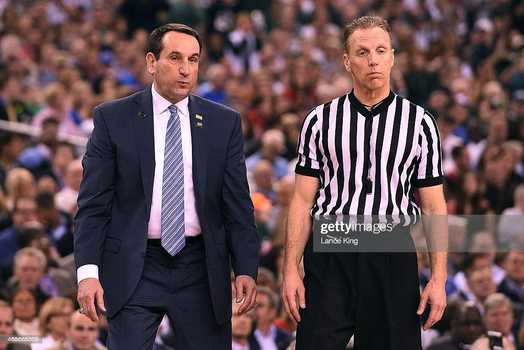 Head Coach Mike Krzyzewski of the Duke Blue Devils and referee Mike Eades look on during a game against the Michigan State Spartans during the NCAA...
