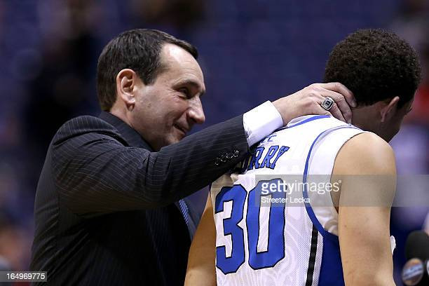 Head coach Mike Krzyzewski of the Duke Blue Devils and Seth Curry celebrate after Duke won 7161 against the Michigan State Spartans during the...