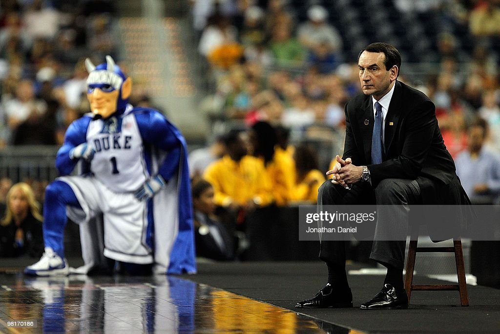 Head coach Mike Krzyzewski of the Duke Blue Devils and the Blue Davils mascot watch as the Blue Devils take on the Purdue Boilermakers during the...