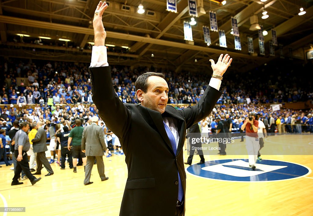 Head coach <a gi-track='captionPersonalityLinkClicked' href=/galleries/search?phrase=Mike+Krzyzewski&family=editorial&specificpeople=213322 ng-click='$event.stopPropagation()'>Mike Krzyzewski</a> of the Duke Blue Devils celebrates after defeating the North Carolina Tar Heels 93-81 at Cameron Indoor Stadium on March 8, 2014 in Durham, North Carolina.