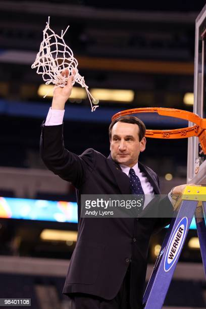 Head coach Mike Krzyzewski of the Duke Blue Devils celebrates after he cut down a piece of the net following their 6159 win against the Butler...