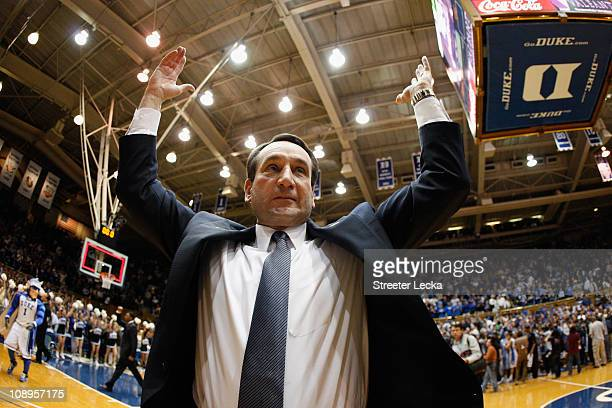 Head coach Mike Krzyzewski of the Duke Blue Devils celebrates with fans after defeating the North Carolina Tar Heels 7973 at Cameron Indoor Stadium...