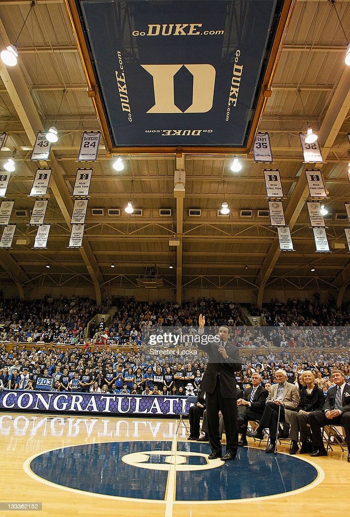 Head coach <a gi-track='captionPersonalityLinkClicked' href=/galleries/search?phrase=Mike+Krzyzewski&family=editorial&specificpeople=213322 ng-click='$event.stopPropagation()'>Mike Krzyzewski</a> of the Duke Blue Devils celebrates with his family, friends and fans as he is acknowledged for breaking the record for wins in NCAA men's basketball at Cameron Indoor Stadium on November 18, 2011 in Durham, North Carolina.