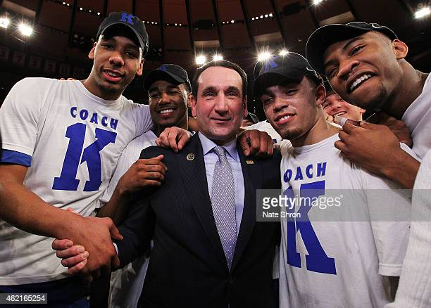 Head coach Mike Krzyzewski of the Duke Blue Devils celebrates with teamates after his 1000th career win after the game against the St John's Red...