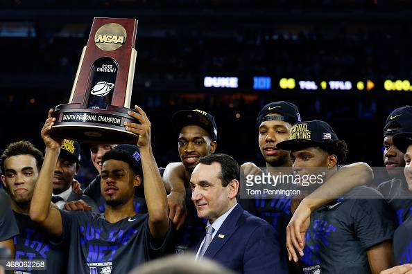 Head coach Mike Krzyzewski of the Duke Blue Devils celebrates with his team after defeating the Gonzaga Bulldogs 6652 during the South Regional Final...