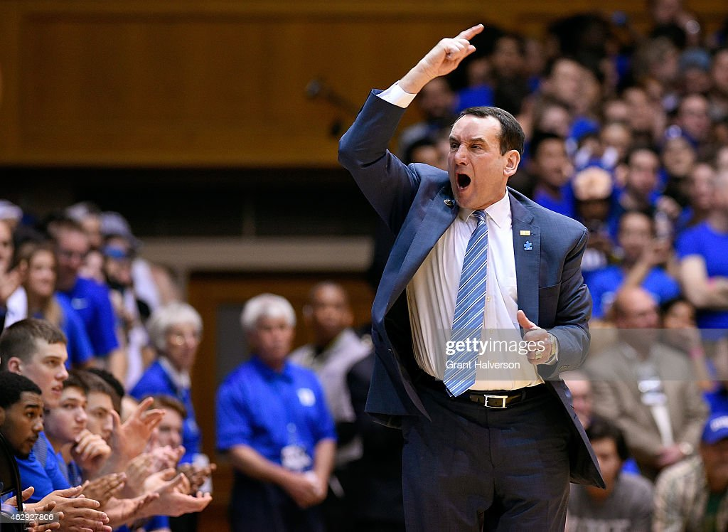 Head coach <a gi-track='captionPersonalityLinkClicked' href=/galleries/search?phrase=Mike+Krzyzewski&family=editorial&specificpeople=213322 ng-click='$event.stopPropagation()'>Mike Krzyzewski</a> of the Duke Blue Devils challenges the fans to get up and cheer during their game against the Notre Dame Fighting Irish at Cameron Indoor Stadium on February 7, 2015 in Durham, North Carolina. Duke won 90-60.