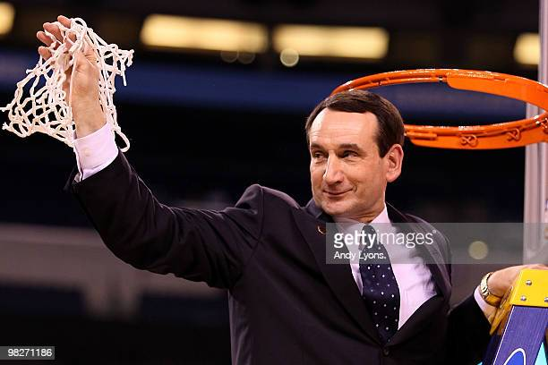 Head coach Mike Krzyzewski of the Duke Blue Devils cuts down a piece of the net following their 6159 win against the Butler Bulldogs during the 2010...