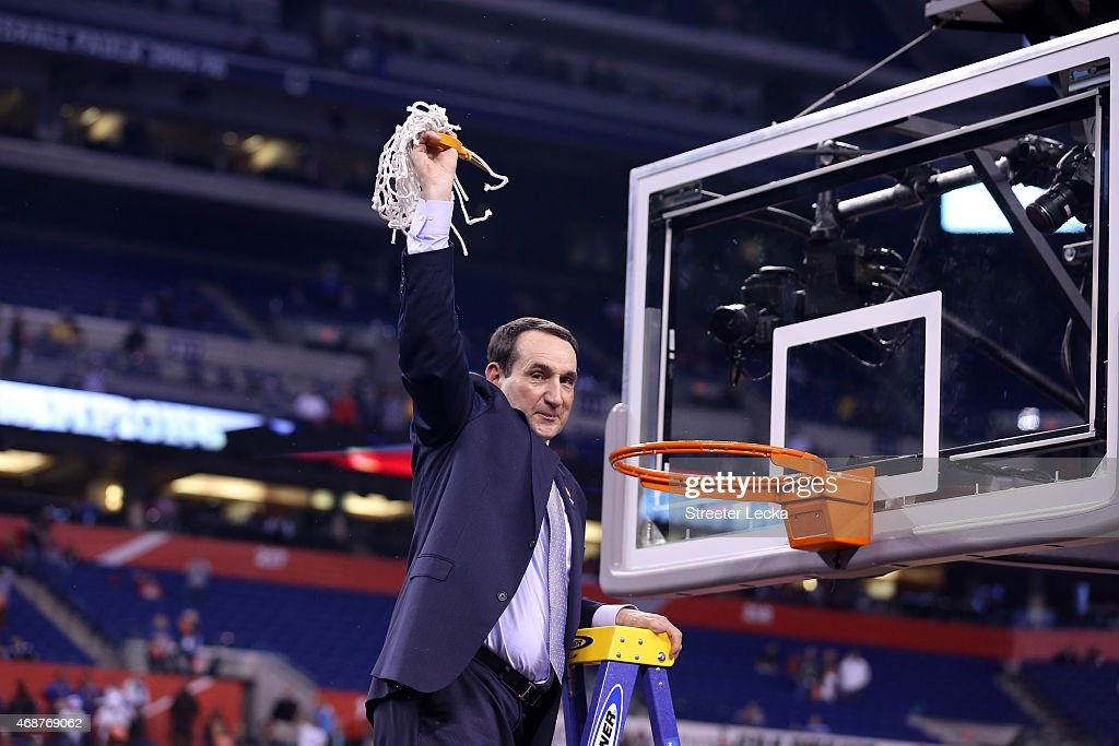 Head coach <a gi-track='captionPersonalityLinkClicked' href=/galleries/search?phrase=Mike+Krzyzewski&family=editorial&specificpeople=213322 ng-click='$event.stopPropagation()'>Mike Krzyzewski</a> of the Duke Blue Devils cuts down the net after defeating the Wisconsin Badgers during the NCAA Men's Final Four National Championship at Lucas Oil Stadium on April 6, 2015 in Indianapolis, Indiana. Duke defeated Wisconsin 68-63.