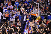Head coach Mike Krzyzewski of the Duke Blue Devils cuts down the net after defeating the Wisconsin Badgers during the NCAA Men's Final Four National...
