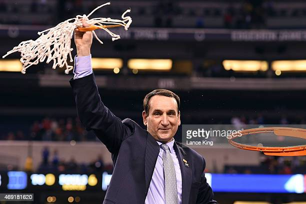 Head Coach Mike Krzyzewski of the Duke Blue Devils cuts down the net after defeating the Wisconsin Badgers during the NCAA Men's Final Four...