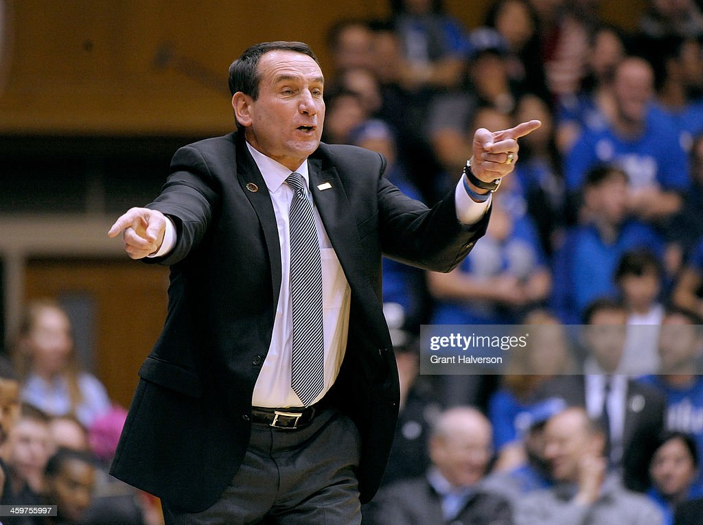 Head coach <a gi-track='captionPersonalityLinkClicked' href=/galleries/search?phrase=Mike+Krzyzewski&family=editorial&specificpeople=213322 ng-click='$event.stopPropagation()'>Mike Krzyzewski</a> of the Duke Blue Devils directs his team against the Eastern Michigan Eagles during their game at Cameron Indoor Stadium on December 28, 2013 in Durham, North Carolina.