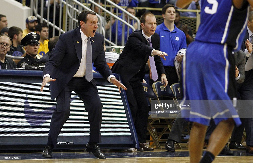 Head coach <a gi-track='captionPersonalityLinkClicked' href=/galleries/search?phrase=Mike+Krzyzewski&family=editorial&specificpeople=213322 ng-click='$event.stopPropagation()'>Mike Krzyzewski</a> of the Duke Blue Devils directs his team against the Pittsburgh Panthers at Petersen Events Center on January 27, 2014 in Pittsburgh, Pennsylvania.
