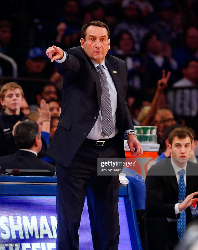 Head coach Mike Krzyzewski of the Duke Blue Devils in action against the UCLA Bruins during the CARQUEST Auto Parts Classic on December 19, 2013 at Madison Square Garden in New York City. Duke defeated UCLA 80-63.