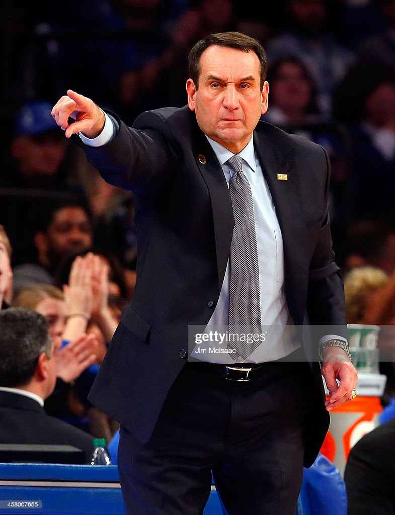 Head coach <a gi-track='captionPersonalityLinkClicked' href=/galleries/search?phrase=Mike+Krzyzewski&family=editorial&specificpeople=213322 ng-click='$event.stopPropagation()'>Mike Krzyzewski</a> of the Duke Blue Devils instructs his team as they play against the UCLA Bruins during the CARQUEST Auto Parts Classic on December 19, 2013 at Madison Square Garden in New York City.