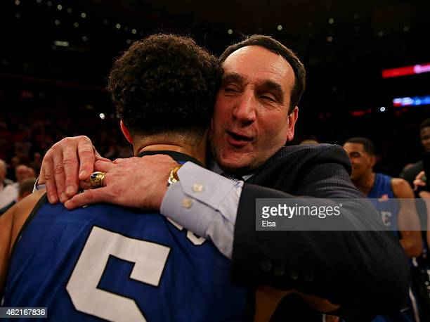 Head coach Mike Krzyzewski of the Duke Blue Devils is congratulated by Tyus Jones after the game against the St John's Red Storm at Madison Square...