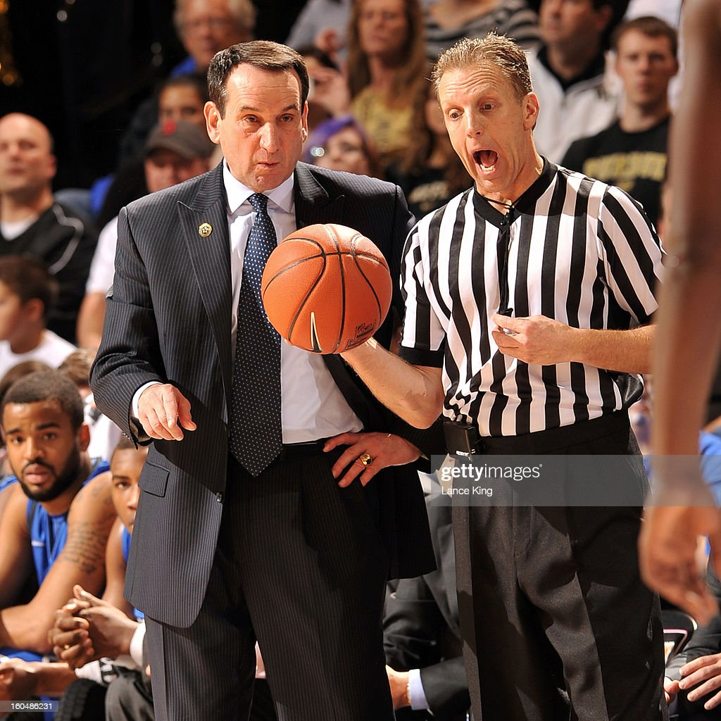 Head Coach Mike Krzyzewski (L) of the Duke Blue Devils listens as referee Mike Eades explains a call during a game against the Wake Forest Demon Deacons at Lawrence Joel Coliseum on January 30, 2013 in Winston-Salem, North Carolina. Duke defeated Wake Forest 75-70.