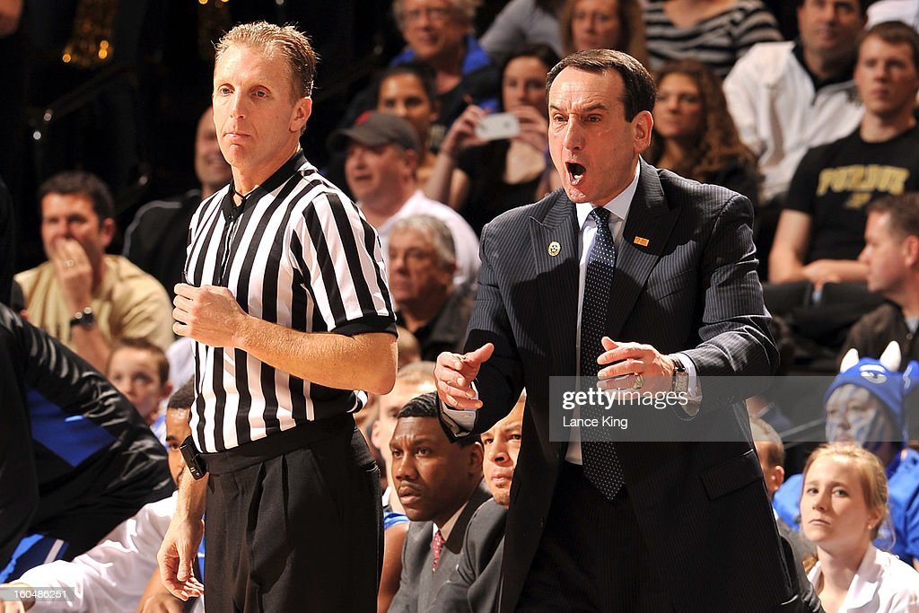 Head Coach Mike Krzyzewski (R) of the Duke Blue Devils reacts as referee Mike Eades looks on during a game against the Wake Forest Demon Deacons at Lawrence Joel Coliseum on January 30, 2013 in Winston-Salem, North Carolina. Duke defeated Wake Forest 75-70.
